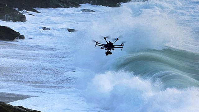 Unmanned Aerial Vehicle (UAV) flying over coastline (Photo: NOAA/MBNMS)